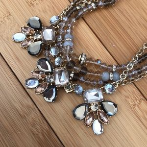 Jewelry - Gold necklace with grey / light rose detail
